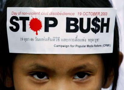 A protest slogan is stuck on the forehead of a young protester during a demonstration in Bangkok October 19, 2003. Several hundred activists chanted anti-U.S. slogans and waved banners against the war in Iraq as President George W. Bush attended the Asia-Pacific Economic Cooperation (APEC) summit in the Thai capital.    REUTERS/Bobby Yip