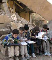 Iraqi children with no classroom studying anyway