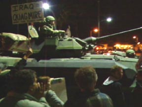 Tanks patrol an anti-war rally in Los Angeles on November 9, 2004